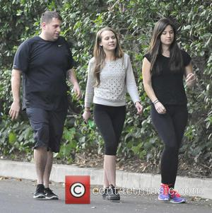 Jonah Hill - Jonah Hill and new girlfriend Isabelle McNally (C) go for an evening hike with a friend in...