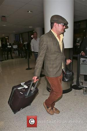 Alan Carr - Alan Carr and partner Paul Drayton arrive at LAX  and goof around at the airport -...
