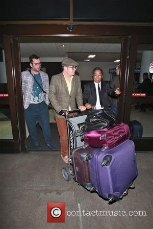 Alan Carr and Paul Drayton - Alan Carr and partner Paul Drayton arrive at LAX  and goof around at...