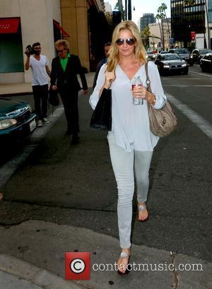 Penny Lancaster - Rod Stewart dressed in green tartan with Penny Lancaster leaving Barneys New York - Beverly Hills, California,...