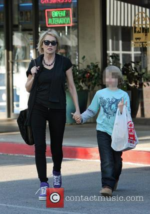 Sharon Stone and Quinn Kelly Stone - Sharon Stone out shopping treating her son at Tom's Toys - Los Angeles,...