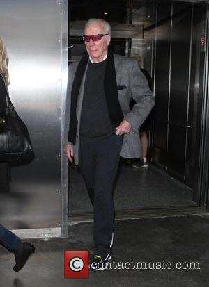 Christopher Plummer - Christopher Plummer arrives at Los Angeles International Airport (LAX) wearing sneakers - Los Angeles, California, United States...