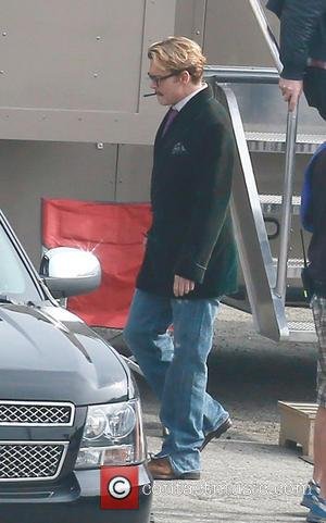 Johnny Depp - Johnny Depp smokes a cigar wearing a smoking jacket while leaving a make up trailer on set...