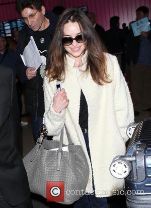 Emilia Clarke - British actress Emilia Clarke arriving at Los Angeles International Airport - Los Angeles, California, United States -...