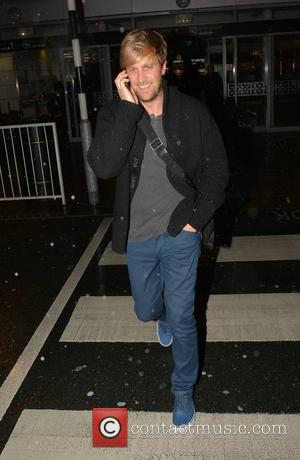 Kian Egan - With his iPhone to his ear Kian Egan touches down at Dublin Airport Arrivals ahead of his...