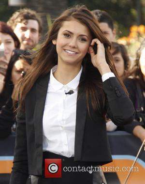 Nina Dobrev - Celebrities appear on 'Extra' at The Grove - Los Angeles, California, United States - Friday 10th January...