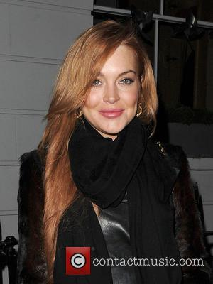 Lindsay Lohan - Lindsay Lohan and a male companion leave...