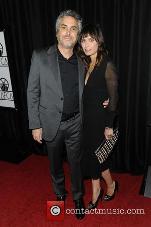 Alfonso Cuaron  Sheherazade Goldsmith - The 39th Annual Los Angeles Film Critics Association Awards - Arrivals - Los Angeles, California,...