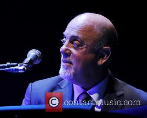 Billy Joel - SUNRISE, FL - JANUARY 11: Billy Joel performs at BB&T Center on January 11, 2014 in Sunrise,...