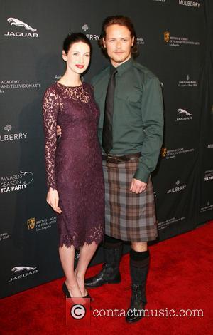 Caitriona Balfe and Sam Heughan - BAFTA 2014 Awards Season Tea Party held at the Four Seasons Hotel in Beverly...