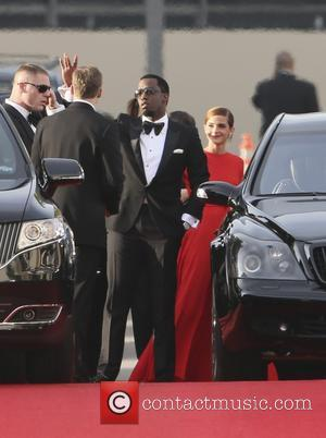 Puff Daddy and Emma Watson - 71st Annual Golden Globe Awards held at the Beverly Hilton Hotel - Arrivals -...