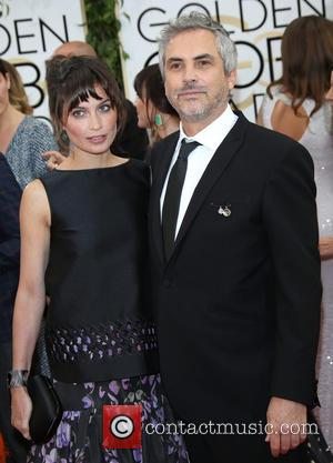 Alfonso Cuaron and Sheherazade Goldsmith - 71st Annual Golden Globes - Red Carpet Arrivals - Los Angeles, California, United States...