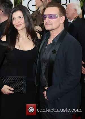 Bono and Ali Hewson - 71st Annual Golden Globes - Red Carpet Arrivals - Los Angeles, California, United States -...