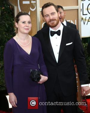 Michael Fassbender and sister - 71st Annual Golden Globes - Red Carpet Arrivals - Los Angeles, California, United States -...