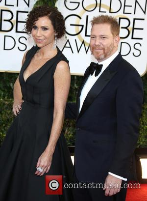 Ryan Kavanaugh and Minnie Driver - 71st Annual Golden Globes - Red Carpet Arrivals - Los Angeles, California, United States...
