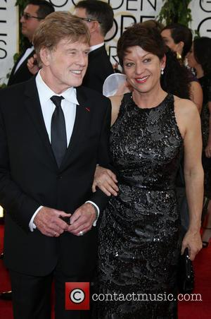 Robert Redford and wife Sibylle Szaggars - 71st Annual Golden Globes - Red Carpet Arrivals - Los Angeles, California, United...