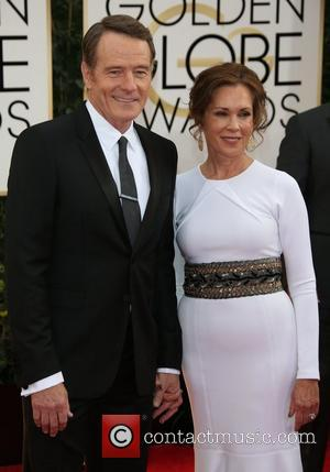 Bryan Cranston and Robin Dearden - 71st Annual Golden Globe Awards held at The Beverly Hilton Hotel  - Red...