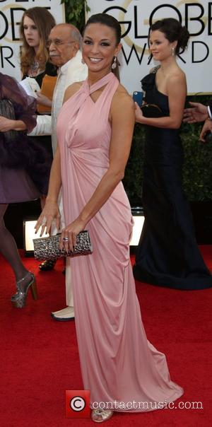 Eva LaRue - 71st Annual Golden Globe Awards held at The Beverly Hilton Hotel  - Red Carpet Arrivals -...