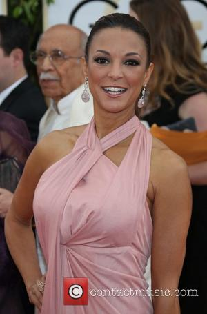 Eva LaRue - 71st Annual Golden Globe Awards held at The Beverly Hilton Hotel  - Red Carpet Arrivals -...