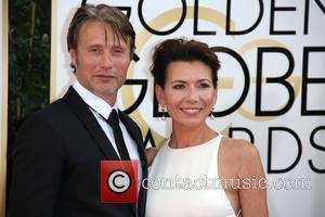 Mads Mikkelsen and Hanne Jacobsen - 71st Annual Golden Globe Awards held at The Beverly Hilton Hotel  - Red...