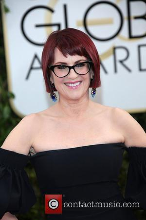 Megan Mullally - 71st Annual Golden Globe Awards held at The Beverly Hilton Hotel  - Red Carpet Arrivals -...