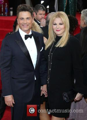 Rob Lowe and Sheryl Berkoff - 71st Annual Golden Globe Awards held at The Beverly Hilton Hotel  - Red...