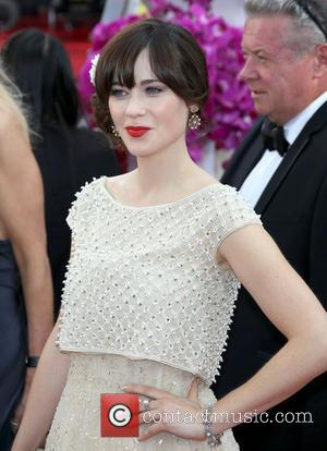 Zooey Deschanel - 71st Annual Golden Globe Awards held at The Beverly Hilton Hotel  - Red Carpet Arrivals -...