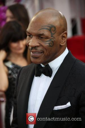 Mike Tyson - 71st Annual Golden Globe Awards held at the Beverly Hilton Hotel - Arrivals - Los Angeles, California,...