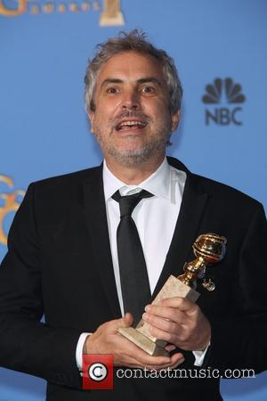 Alfonso Cuaron - 71st Annual Golden Globes - Press Room - Los Angeles, United Kingdom - Sunday 12th January 2014