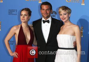 Amy Adams (r-l), Bradley Cooper and Jennifer Lawrence