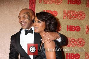 Mike Tyson and Angela Bassett