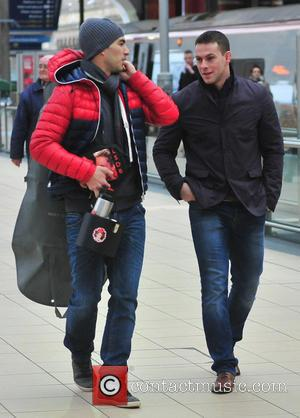 Luis Suarez - Liverpool football players and their partners leaving Liverpool Lime Street station for London. The team were heading...