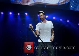 Adam Levine - Maroon 5 performing live on stage at Manchester Phones4U Arena - Manchester, United Kingdom - Monday 13th...