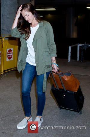 Minka Kelly - Minka Kelly arrives at Los Angeles International (LAX) airport - Los Angeles, California, United States - Monday...