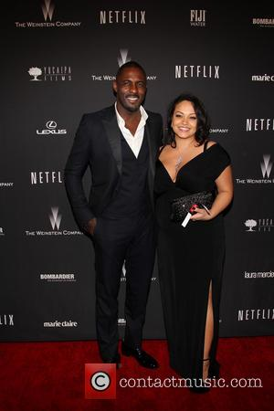 Idris Elba and Naiyana Garth - The 71st Annual Golden Globe Awards - Weinstein Party  at The Beverly Hilton...