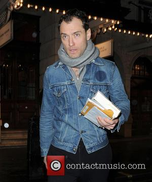 Jude Law - Jude Law leaving the Noel Coward Theatre in a denim jacket after his performance in 'Henry V'...
