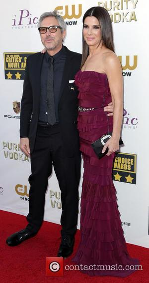 Alfonso Cuaron and Sandra Bullock - The 19th Annual Critics' Choice Awards at The Barker Hangar - Arrivals - Los...