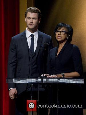 Chris Hemsworth and Academy President Cheryl Boone Isaacs