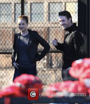 Emily Vancamp and Barry Sloane - Actress Emily Vancamp smooches with her co star Barry Sloane on the set of...