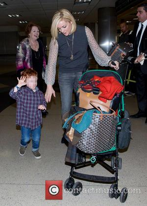 Jane Krakowski and Bennett Robert Godley - Jane Krakowski and her son, Bennett at Los Angeles International Airport - Los...