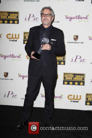 Alfonso Cuaron - The 19th Annual Critics' Choice Awards - Press Room at The Barker Hangar - Santa Monica, California,...