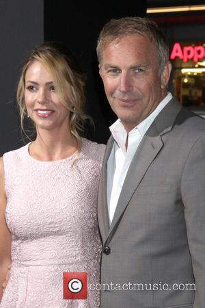 Kevin Costner and Christine Baumgartner - Jack Ryan Shadow Recruit LA Premiere at Chinese Theater in Los Angeles - Los...