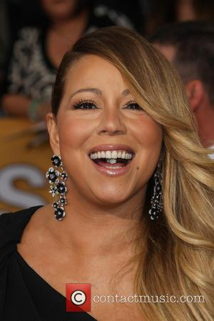 Mariah Carey Wears Eye-popping Sexy Black Dress At Bet Honors