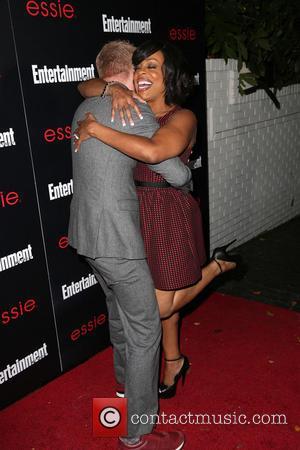 Jesse Tyler Ferguson and Niecy Nash