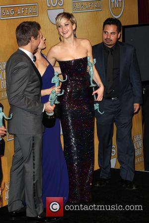 Jeremy Renner and Jennifer Lawrence