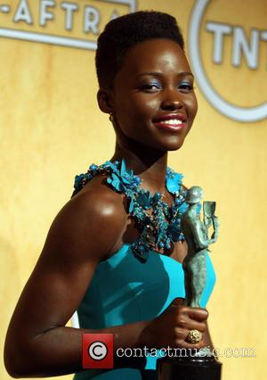 Pga Awards 2014: Leonardo Dicaprio Basks In Lupita Nyong'o's '12 Years A Slave' Stardom