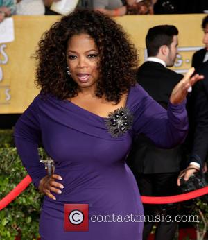 Oprah Winfrey - The 20th Annual Screen Actors Guild (SAG) Awards held at The Shrine Auditorium - Arrivals - Los...