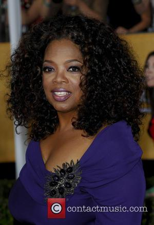Oprah Winfrey - The 20th Annual Screen Actors Guild Awards arrivals - Los Angeles, California, United States - Sunday 19th...