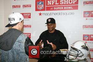 Victor Cruz - Gridiron great, Victor Cruz meets fans at the NFL Shop at Super Bowl in Macy's Herald Square...