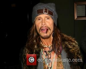Steven Tyler - Steven Tyler spotted leaving Craig's restaurant in West Hollywood smoking a cigar - Los Angeles, California, United...